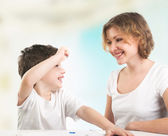 Mother with her son having fun with crayons — Stock Photo