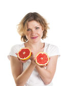 Beautiful woman with grapefruit — Stockfoto