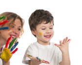 Mother and her son having fun with paints — Stock Photo