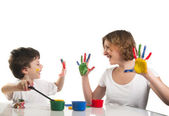 Happy mother and her son having fun with paints — Stock Photo