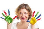 Smiling woman with hands painted with colorful paint — Stock Photo