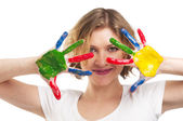 Happy woman with hands painted with colorful paint — Stock Photo