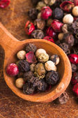 Different peppercorns — Stock Photo