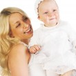 Smiling mother holding her baby girl — Stock Photo #31193979