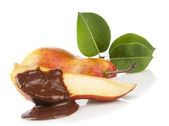Pear with chocolate and green leaves — Stock Photo