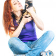 Woman sitting on the floor and looking at ferret — Stock Photo #33183885