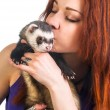 Red haired woman kissing ferret — Stok fotoğraf