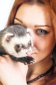 Red haired woman and cute ferret — Stock Photo