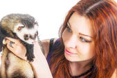 Beautiful woman looking at ferret — Stock Photo