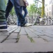 Stock Video: Bicycle parking lot and passersby in Amsterdam
