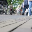 Stock Video: Passersby and bicycle parking in Amsterdam