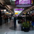 Duty free shops in the Schiphol Airport, Amsterdam, Netherlands. — Stok fotoğraf