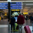 People in Schiphol Airport, Amsterdam, Netherlands. — Stockfoto