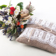 Vintage wedding pillow and flowers — Stock Photo