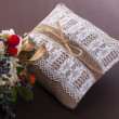 Vintage wedding  pillow with ring and field flowers — 图库照片