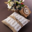 Vintage wedding pillow with ring and bouquet in box — Stock Photo