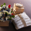 Vintage wedding pillow with ring and flowers in box — Stock Photo
