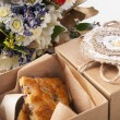 Cookies in vintage box with field flowers — Stock Photo