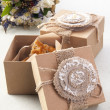 Cookies in vintage boxes with field flowers — Stock Photo
