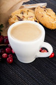 Cup of coffee with cowberry cookies and berries — Stock Photo