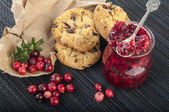 Cowberry jam with cookies — Stock Photo
