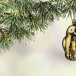 Vintage owl toy on the Christmas cedar — Stock Photo