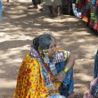 Indian woman offering people to buy her goods on the Mandrem market — Stok fotoğraf