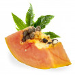 Fresh papaya with green leaves — Stock Photo