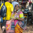 Woman in authentic clothing on the Mandrem market — Stok fotoğraf