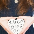 Ornate heart in female hands — Stock Photo