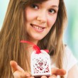Woman holding Valentine's Day gift — Stock Photo