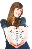 Young woman giving ornate heart — Stock Photo