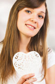 Young woman and ornate heart — Stock Photo