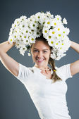 Woman holding chrysanthemum bouquet above her head — Stock Photo
