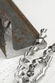 Metalwork with metal invoice and shavings — Stock Photo