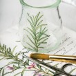Decoupage vase with rosemary, scissors and brush — Stock Photo