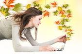Creative autumn wind from laptop — Stock Photo
