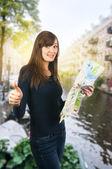 Tourist woman and city map — Stock Photo