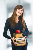 Cheerful student holding books — Stock Photo