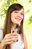 Woman holding a glass of water — Stock Photo