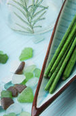 Stones and green aromatic sticks — Stock Photo