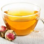 Cup of flowering tea — Stock Photo