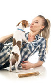 Woman kissing puppy — Stock Photo