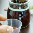 Herbal cough syrup — Stock Photo #42554519
