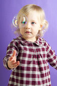 Baby girl with bubble — Stock Photo