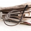 Newspapers and glasses — Stock Photo #4310362