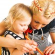 Mother and daughter drawing — Stock Photo #43256037