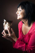 Woman smelling aromatherapy oil burner — Stock Photo