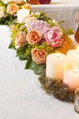 Decoration with candles and flowers — Stock Photo