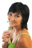 Mature woman with essential oil — Stock Photo